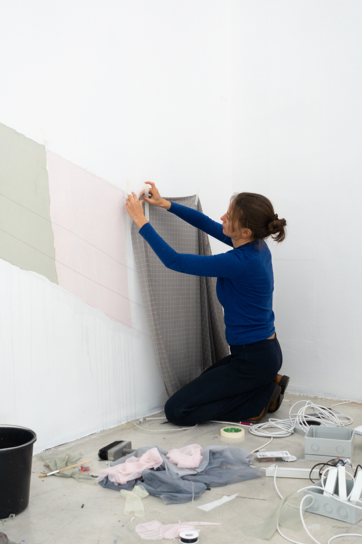 Olga Pedan during the set up of the exhibition self conscious hosted by AETHER.