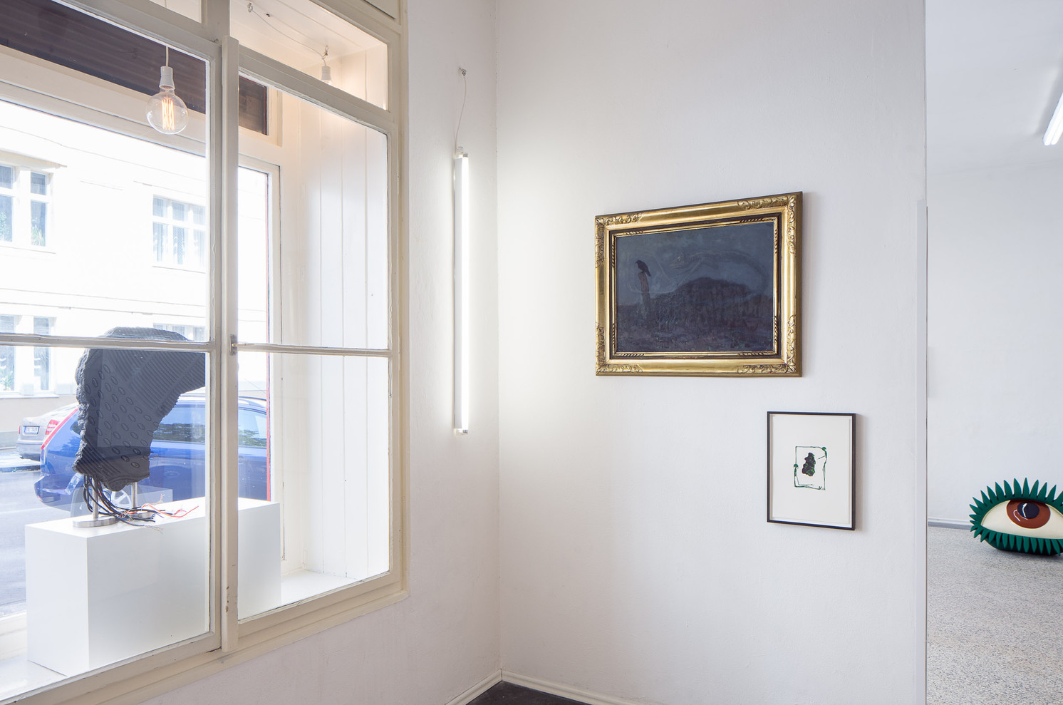 corner with paintings and sculptures
